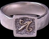 Sagittarius Zodiac Jewelry hand made 14 K yellow gold symbol and sterling silver hammer textured sagittarius ring by Rubyblue Jewelry