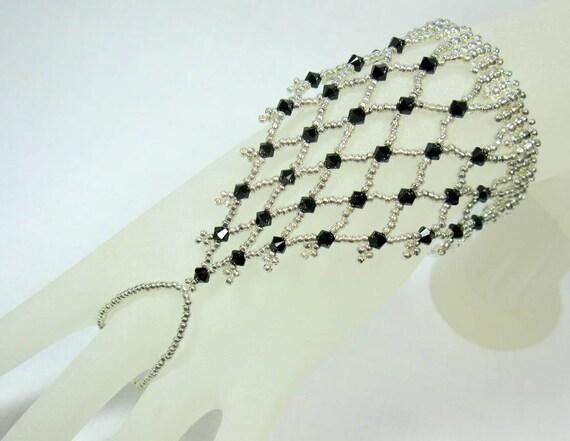 Items similar to Black Crystal Slave Bracelet - Small size. Netted Swarovski Jet Black crystal and Silver seed bead slave bracel