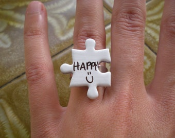 Puzzle ring 'HAPPY'