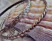 2 Gold Tone Bangle Bracelets