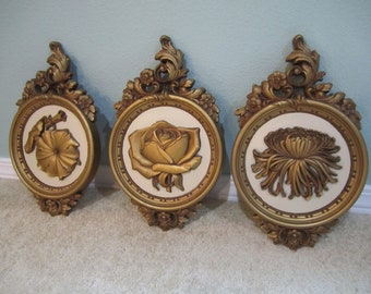 3D floral dart wall plaques gold and cream tone molded plastic from the 70s