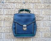 reserved 80s heavy leather lover green brown black little side bag / circular clicky closure 6 pocket purse