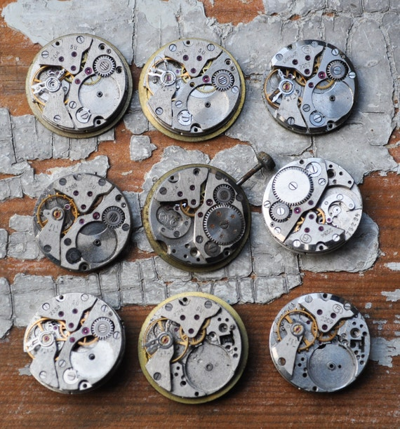 0.8 inch Set of 9 vintage watch movements.