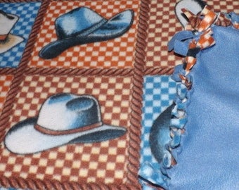 Fleece blanket,cowboy hats ,other side is all medium blue.. Will fit a gueen size bed
