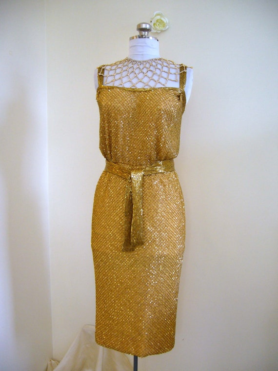 glass beaded wiggle dress by Ceil Chapman from the 1950s