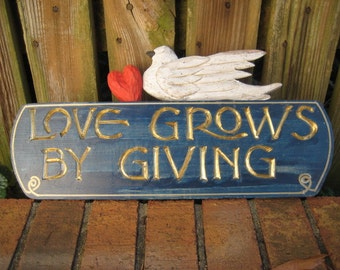 Love Grows By Giving Sign