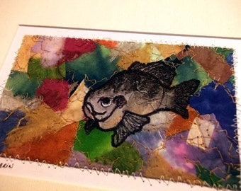 Fiber art, fish sketch on mixed-media abstract background, matted