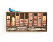 NEST an original mixed media assemblage using box compartments vintage blocks architectural salvage by Elizabeth Rosen