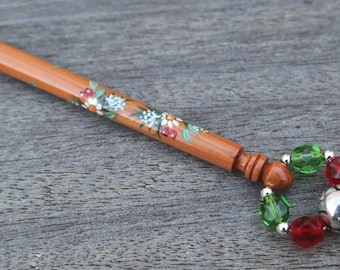 Painted Lace Bobbin - a spiral of fir branches, white flowers, berries and leaves on a Yew Midland bobbin