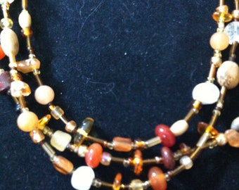 Triple strung multistone necklace in warm tones. Coupons available for discounts