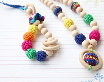 Bright set of 2. Teething ring toy and nursing necklace. Multicolor rattle for baby and mom.