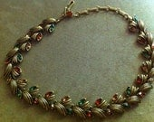 Goldtone choker with multicolor gems