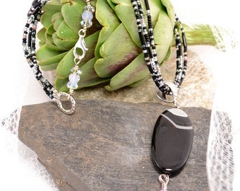 Banded Black Agate Three Strand Pendant Necklace with Crystals