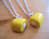 Split Twinkie best friends necklaces made from polymer clay