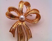 Reserved for Kenny, See CLOSEOUTSALE 50% Coupon, Napier Goldtone Bow Brooch with Faux Pearl Center