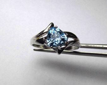 Elegant Genuine Swiss Blue Topaz Trillion in Sterling Silver Ring