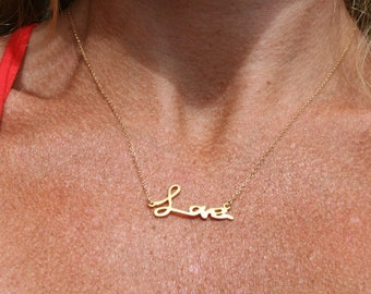 14kt gold necklace with love pendant. Celebrity inspired cursive love necklace.  Celebrity inspired jewelry