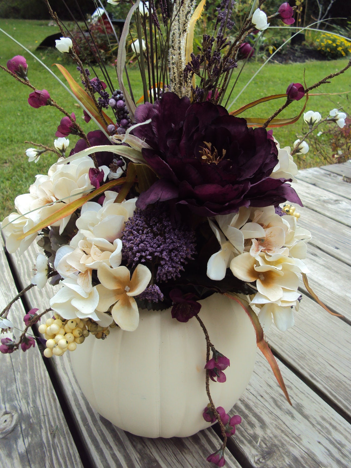 Large elegant purple floral white pumpkin table centerpiece