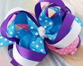 Layered Boutique Bow in purple, white, blue and pink