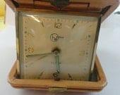 Vintage German travel clock, Helbros, case of tan pigskin, winds up, ticks, alarm sounds