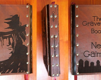 Leather covered The Graveyard Book by Neil Gaiman