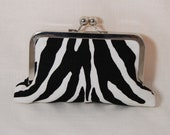 Animal print small clutch with black linen lining and nickel frame