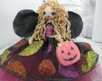 Halloween trick or treat Fairy Blonde curly hair Blue eyes Black polka dot dress