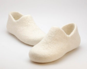 Felted slippers from natural white wool