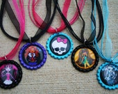 Monster High inspired color bottle cap necklaces. Comes with your choice of color ball chain or organza ribbon.