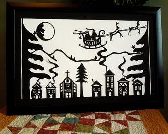 Retro Paper Cut Christmas Village with Santa Sleigh Reindeer Laughing Moon Wall Art