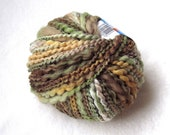Ornaghi Filati Norfolk 100. bulky colorful thick and thin wool blend. olive green, brown, golden yellow..