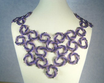 Rings of purple and black necklace