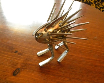 Baby Forkupine, repurposed silverware, metal sculpture