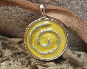 Silver 3D Spiral with a Yellow Background in a Small Silver Round Pendant