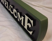 Handcarved cypress welcome sign - green border with white letters
