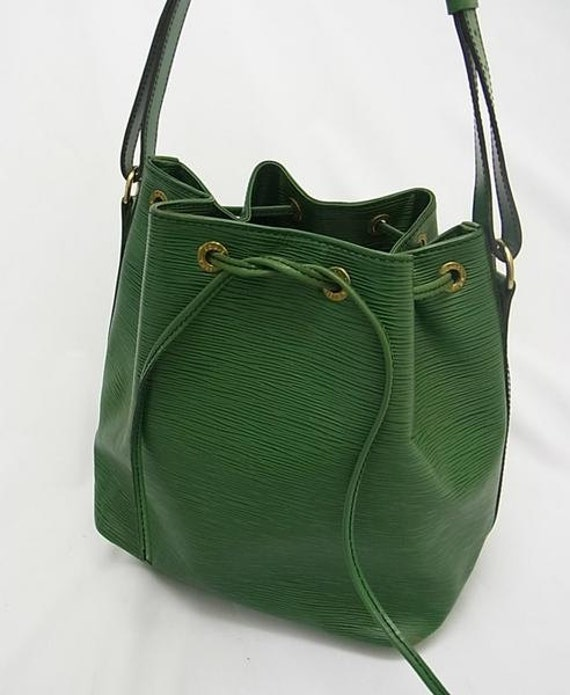 Vintage Louis Vuitton epi bucket  in green. Stunning color as an accent.