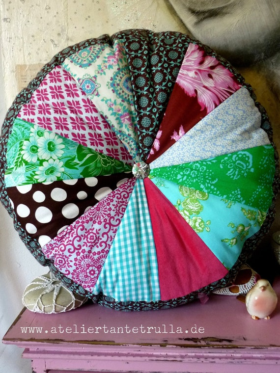patchwork cushion round with sparkling glassbutton