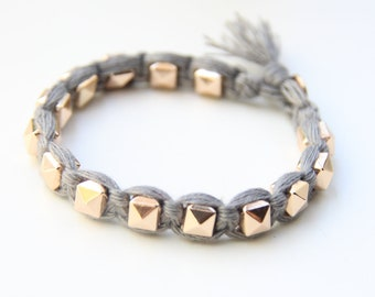 ON SALE! Arm candy - Gold pyramid beads and grey cord - woven bracelet