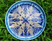 Medium size plate in shades of blue with pineapple and pineapple plant stencil