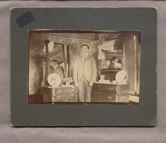 antique photo matted image MAN in ROOM with mirrored DRESSERS paper ephemera