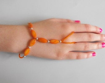 SALE - Orange bead Slave Braclet, ring bracelet, with orange dyed shell beads, seed beads and silver lobster claw clasp and extension chain.