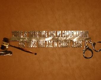 Metal wall sculpture of Romans 8:1