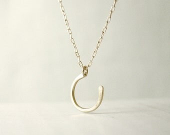 Small horseshoe sideways necklace - hammered brass on gold filled