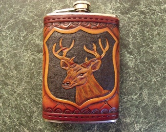 Handcrafted leather bound Stainless steel drinking flask with deer. Can be personalized .