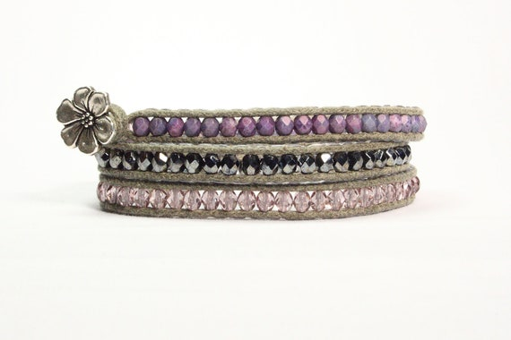 Wrap bracelet.  Czech fire polish glass beads in lavender purple, graphite gray and pink mauve. Silver flower button.