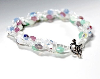 Beaded Spiral Bracelet. White Seed Beads, Pastel Colored Faceted Beads, and Toggle Clasp