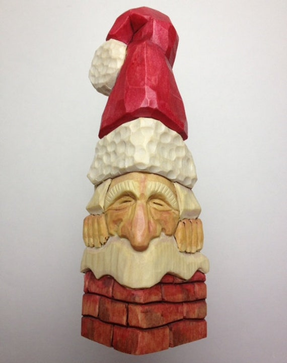 Hand carved santa in chimney christmas ornament