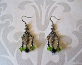 antiqued bronze chandelier earrings. green and black crystal beads. bold. dangle.