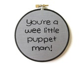 SALE - Angel Embroidery Hoop Art : Wee Little Puppet Man - Whedon TV Quote - Gray and Black Fiber Art 4 inch