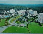 Vintage unused color postcard Concord Resort Hotel(demolished in 2008) Kiamesha Lake, N.Y. Famous  Borscht Belt Catskill Hotel early 1960's